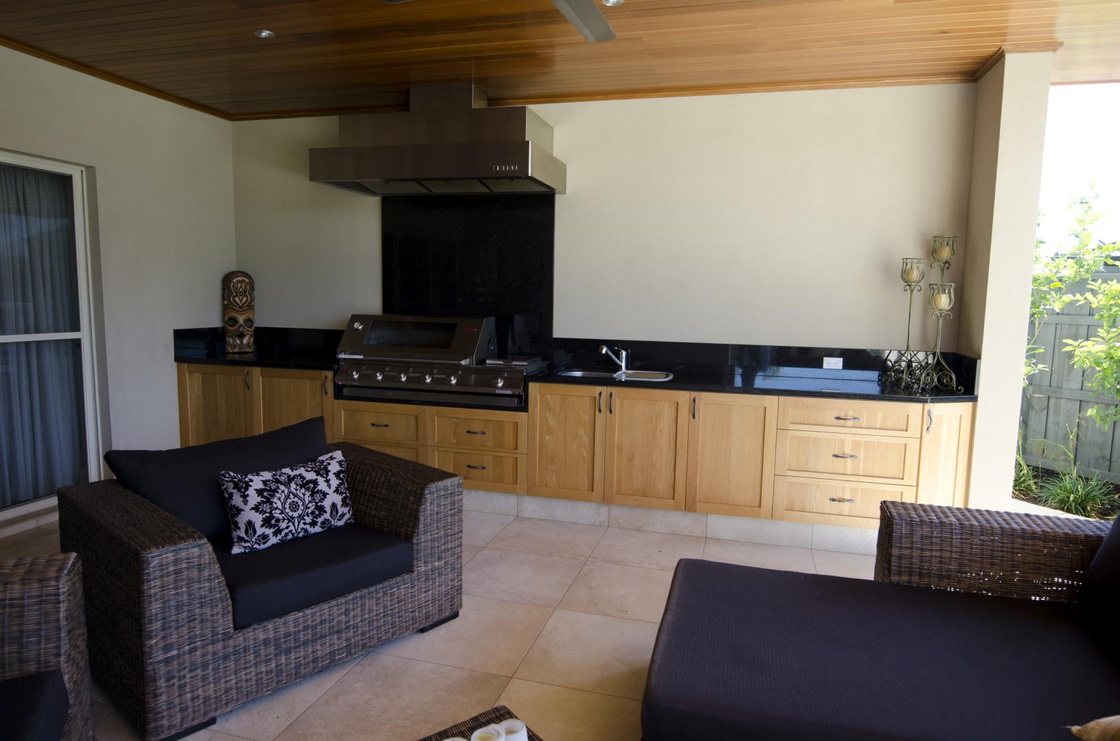 BBQ benchtop and splashback from Absolute Black Granite.