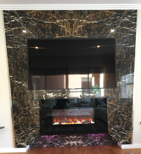 custom designed TV/Fireplace mad from book matched marble