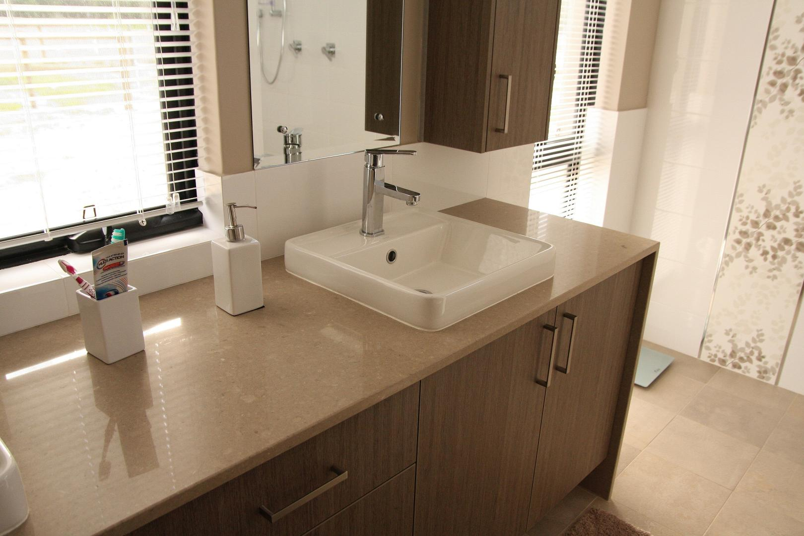 Ensuite vanity with Caesarstone Shitake 4230 benchtop with waterfall end.