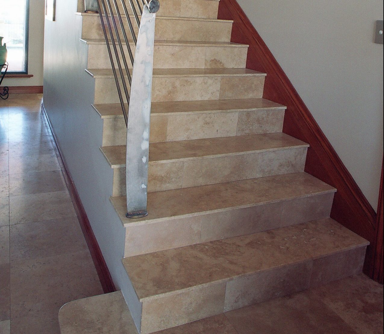 Steps and risers tiled with marble tiles.